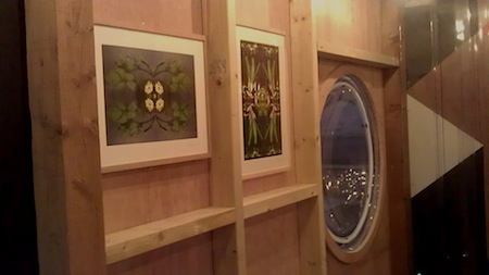 inside the MVMENT cafe, looking at some of the framed prints